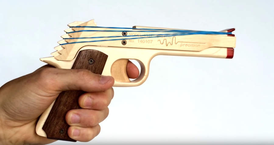 pistola de madera lanza ligas
