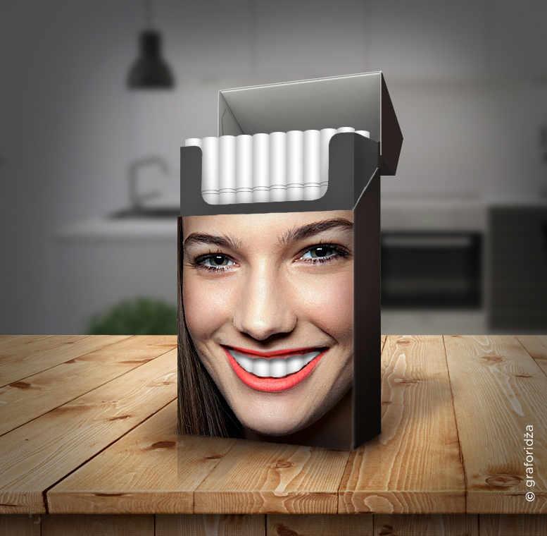 caja de cigarros y dientes