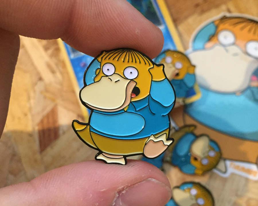 pines metálicos de Pokémon y de los Simpsons