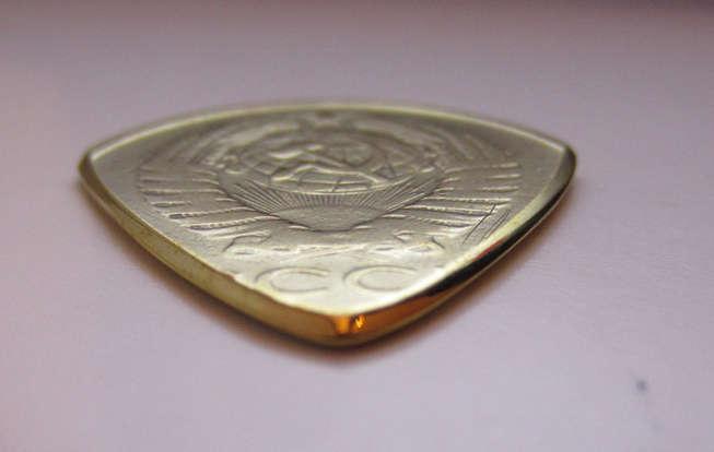 moneda púa