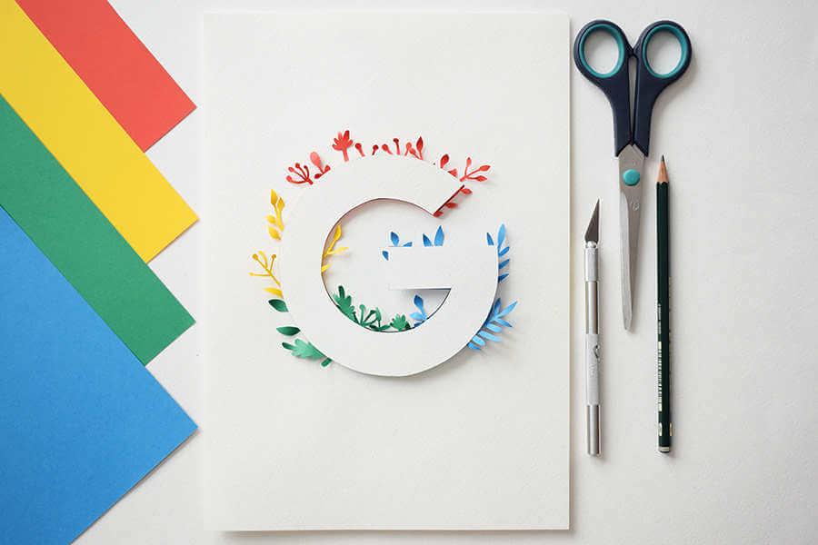 Isotipos hechos de papel recortado