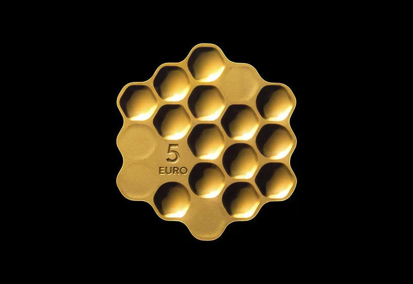 Moneda con forma de panal